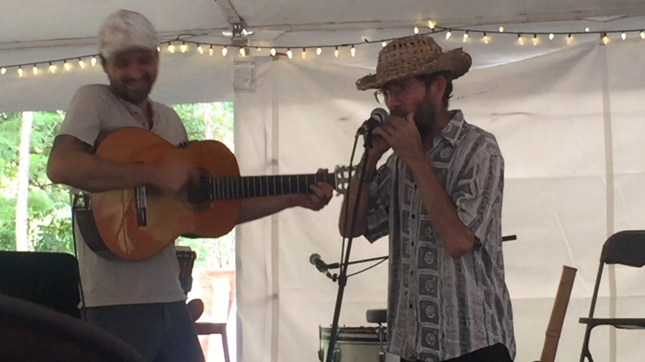 Naturalist, storyteller, and herbalist Doug Elliot singing in honor of Jim Duke at the dedication of the Center for Medicinal Plant Conservation at the United Plant Savers sanctuary.
